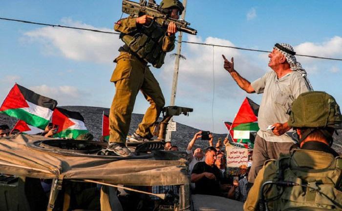 24h qua ảnh: Binh sĩ Israel chĩa súng vào người biểu tình Palestine